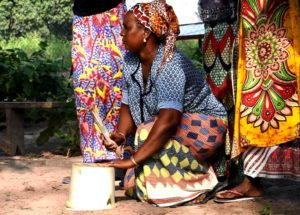 Woman using a bucket as percussion
