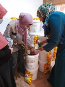 Nardin distributing hygiene kits as part of an APS project in Irbid, Jordan